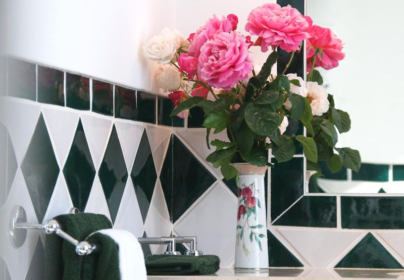 Roses in green bathroom
